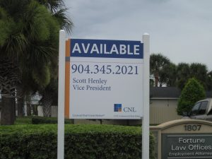 post and panel outdoor real estate sign